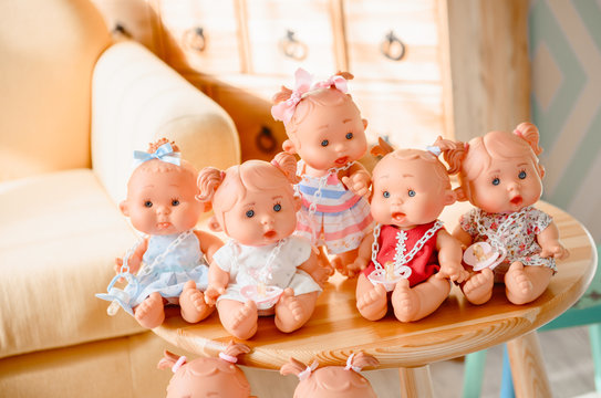 Group of cute baby dolls  on bright background