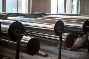 Metal axes and steel rollers in factory workshops