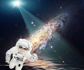 Wall Murals Nasa Space collage. Alien planet and astronaut. Light beam on the above. Elements furnished by NASA.