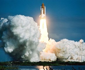 Papiers peints Nasa Rocket takes off into the sky. Lots of smoke and gas. The elements of this image furnished by NASA.