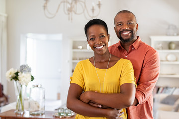 Mature black couple hugging and smiling