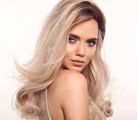 Foto op Canvas Kapsalon Ombre blond wavy hair. Beauty fashion blonde woman portrait. Beautiful girl model with makeup, long healthy hairstyle posing isolated on studio white background.