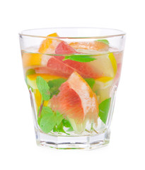 cold drink with different citrus and herbs in glasses on a white background. Cocktail