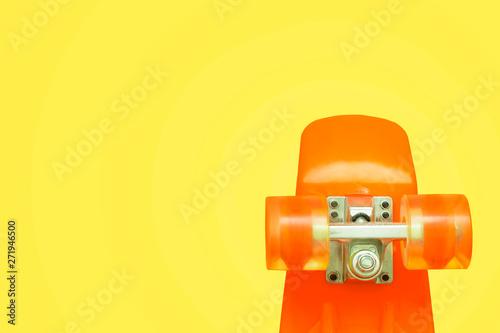 Orange Plastic Mini Cruiser Board On Yellow Background