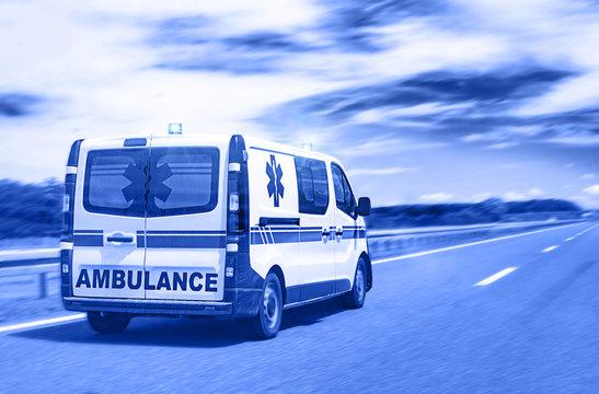 Ambulance van on highway with flashing lights