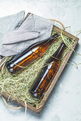 Craft beer with dried grass in wooden box
