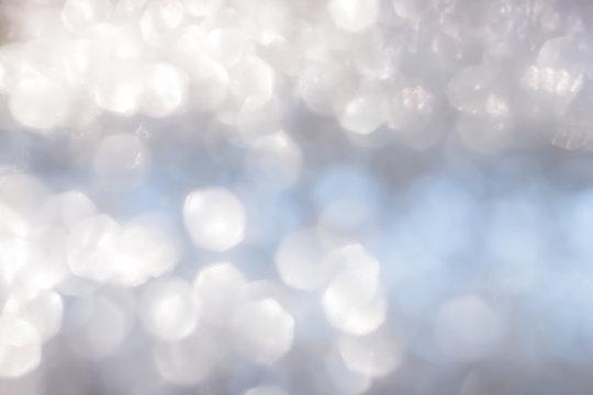 Blur abstract background silver bright sparkling white light glittering bokeh illumination