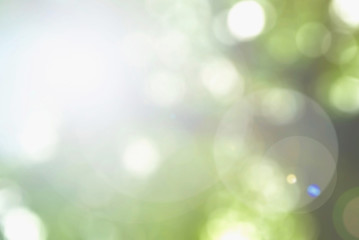 Blurred sky background with nature glowing sun light flare and bokeh