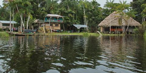 Houses in the village Santa Clara near Puerto Narino at Amazonas river in Colombia