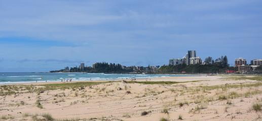 View of Coolangatta from Tugun Esplanade. People relaxing and sunbathing on Kirra Beach.