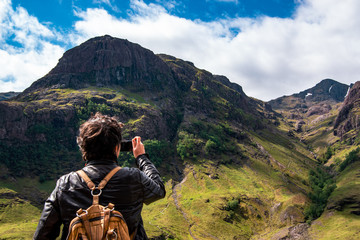 Panoramic view of the Three Sisters of Glencoe with tourist, Scotland, UK.