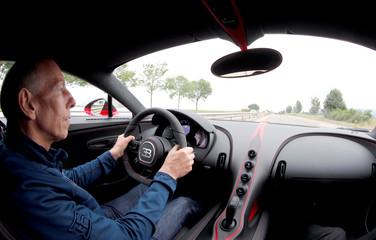British race driver and 1988 Le Mans winner Wallace drives a Bugatti Chiron sports car on a motorway near Molsheim,