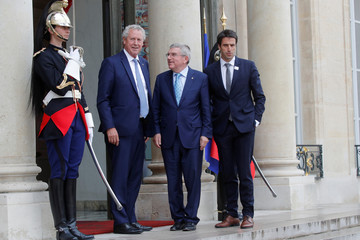 Thomas Bach, President of the International Olympic Committee (IOC), Guy Drut, IOC member, and Paris 2024 President Tony Estanguet arrive for a meeting at the Elysee Palace in Paris