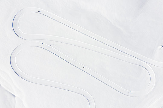 Aerial view of skiing track on snowy landscape