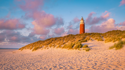 Lighthouse texel Island Netherlands, Lighthouse during sunset on the Island of Texel Wall mural