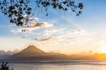 Sunset view over Lake Atitlan & San Pedro volcano in Guatemalan highlands, Central America