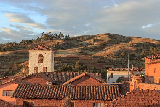 sunset over peruvian village Chinchero in the andes, peru