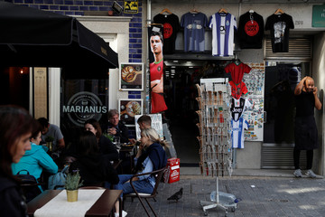 A picture of Portugal's Cristiano Ronaldo is displayed outside a souvenir store ahead of UEFA Nations League final between Portugal and Netherlands, in Porto