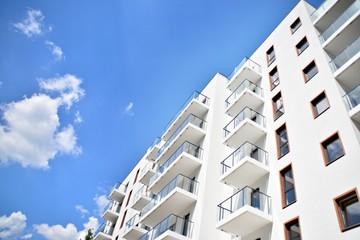 Modern apartment buildings on a sunny day with a blue sky. Facade of a modern apartment building Wall mural