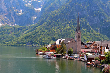 Famous Austria village Hallstatt with church and lake