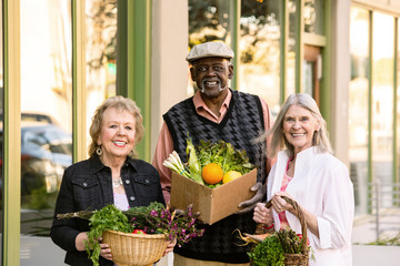 Three Seniors Returning from Farmers Market with Groceries