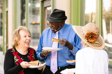 Senior Trio Eating Tasty Street Food