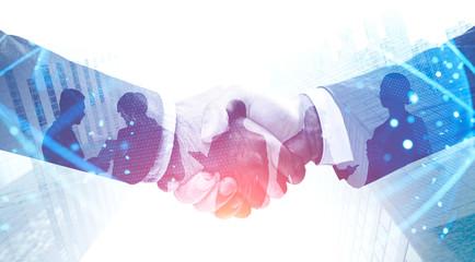 Handshake in city, international partnership