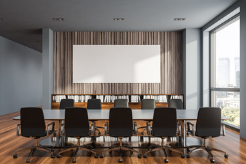 Gray and wooden meeting room with poster