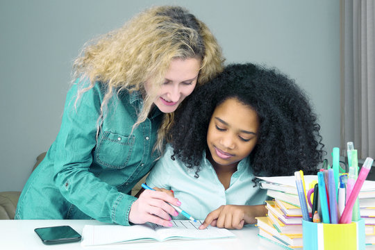 mom helps her daughter to the school to do the lessons.