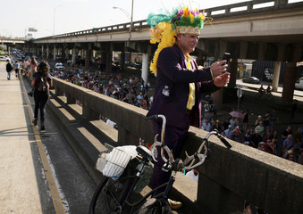 Chet Pierson takes a photograph of a second-line parade celebrating the late New Orleans musician Dr. John in New Orleans