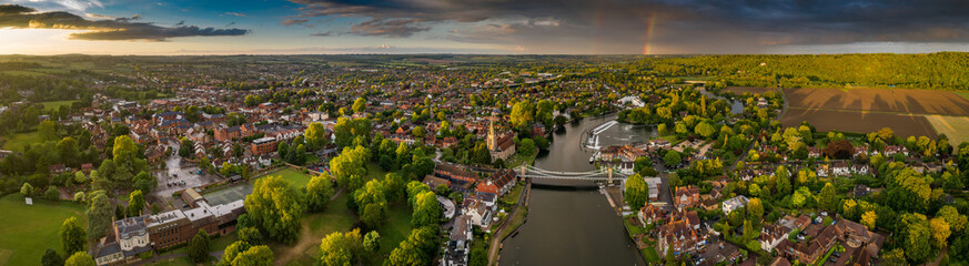 Dramatic aerial panoramic view of the beautiful town of Marlow in Buckinghamshire UK, captured after a rain storm, with a rainbow on the horizon Fototapete