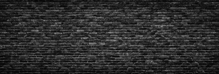 Black brick wall background.  stonework texture gloomy, panoramic view