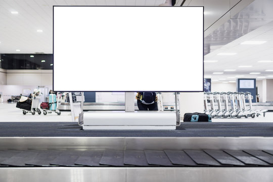 Blank advertising billboard at conveyor belt luggage in airportat airport. Copy space for cutomer text information advertise about tourism transport business etc.