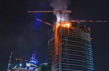 A huge fire engulfed the top floors of a brand new skyscraper in Warsaw