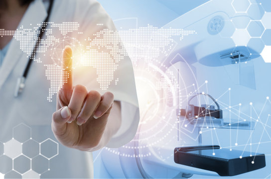 female doctor with stethoscope hand pointing touching world map data digital icon hologram with Mammography X-Ray System Machine in hospital background, medical innovation, future technology concept
