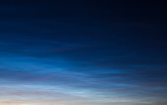 Noctilucent clouds on sunset.