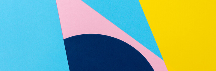 Abstract geometric shape yelllow, light blue and pastel pink color paper background