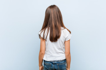 Cute girl from behind, looking back.
