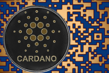 Token ada cardano coin cryptocurrency on the background of gold crypto code