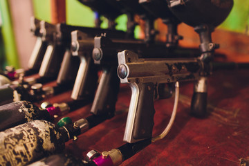 Paintball guns on a wooden table. play paintball.