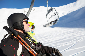 Man and woman in ski lift