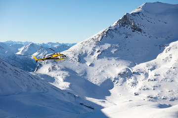 Rescue helicopter flying in snowy landscape