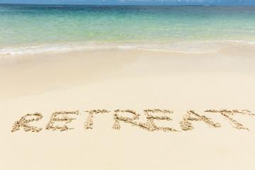 Retreat Text On Sand Near The Idyllic Sea At Beach