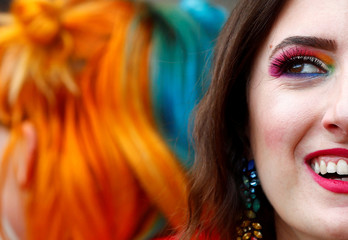 A person smiles during the Gay Pride Parade in Rome