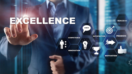 Achieve Business Excellence as concept. Pursuit of excellence. Blurred business center background.