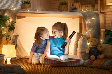 children are reading a book