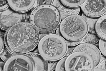 black and white picture background with one and two Euro coins format filling
