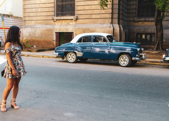 Colorful street and old car in Havana, Cuba