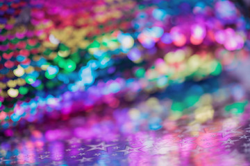 Sparkling glitter abstract background purple blue desaturated color, fluid defocused, macro. Sequins sparkling over silver stars, bright tender pastel bokeh. party festive background