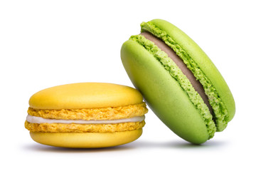 Poster Macarons Yellow and green macaron cookies isolated on white background